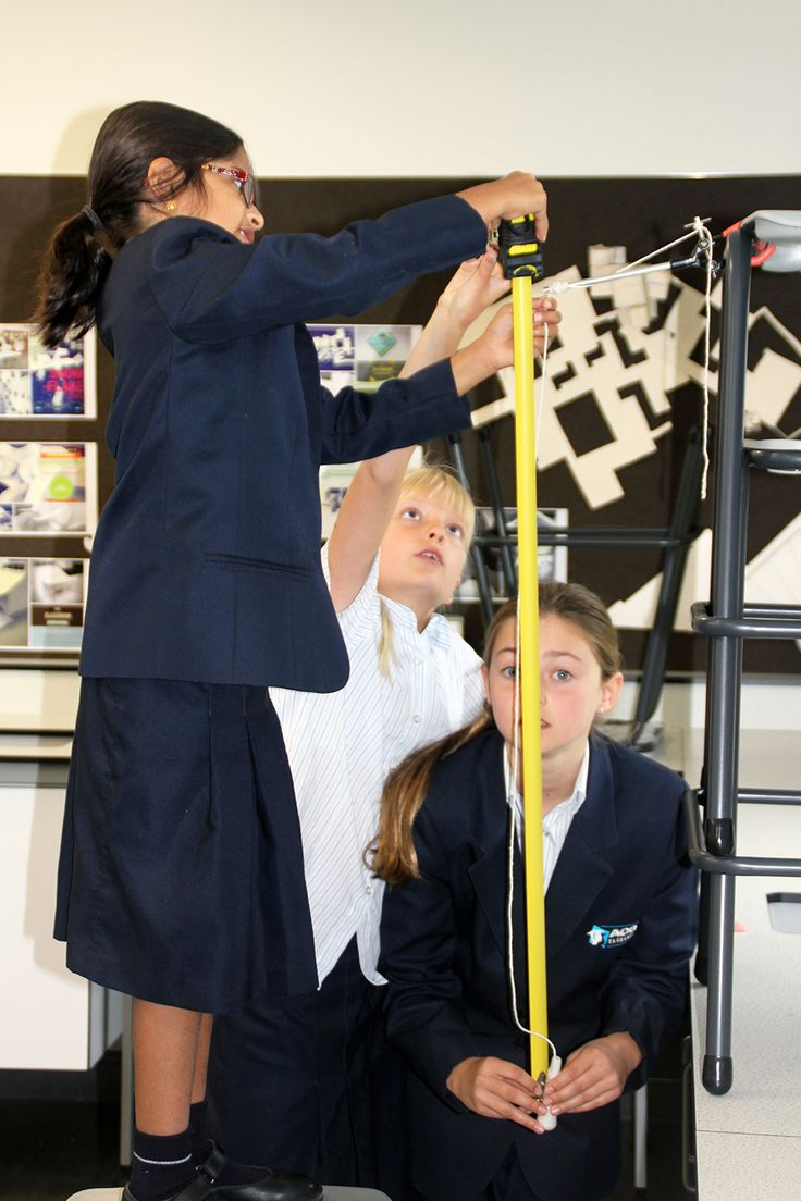 Year 5 and 6 students making a pendulum clock