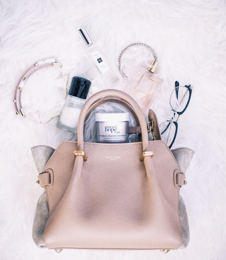 Flatlay. Nina ricci bag. Alexis bittar necklace. Mac cosmetic primer. Philosopher renew hope face lotion. Jo Malone blue bell perfume. Chanel mademoiselle perfume. Oliver people's glasses