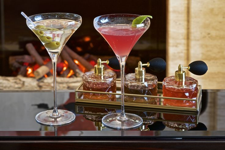 Cocktails by the fireplace at The Gallery Lounge at Four Seasons Hotel Prague