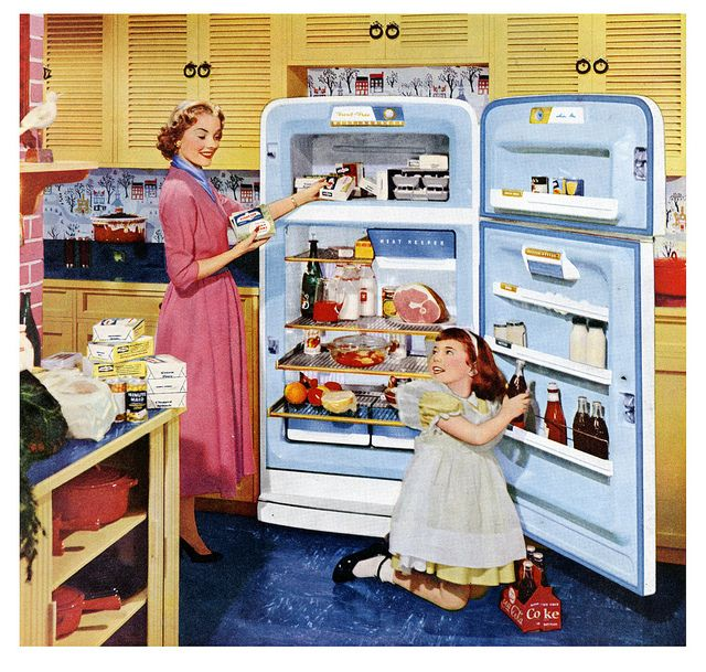 A mother and daughter put away their weekly grocery shopping in this lovely Westinghouse refrigerator ad from 1953.