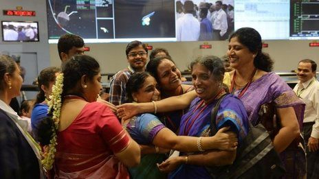 Date of Coverage: 25-SEP-14: When the crowded command control room of India's Mars mission exploded into applause after it successfully put a satellite into orbit around the Red Planet, photographer Manjunath Kiran of the AFP news agency clicked this remarkable image of scientists congratulating each other.