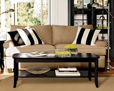I like the contrasting stripes on the neutral couch and black furniture.