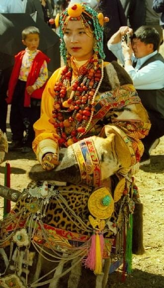King Gesar Arts Festival in Kardze, Kham, Tibet 2003 | The bead worn this lady's wears in the centre of her forehead is almost definitely an ancient dZi. Other dZi that she ways may also be ancient. She is from Pelyul in Kham, easily recognised from her headdress