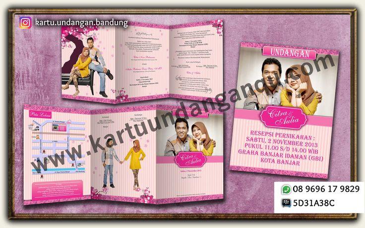 Undangan Soft Cover lipat 3, Bahan Art Papper + Laminasi Doff. Memanfaatkan Photo Pre Wedding yg lucu dominan warna Pink yg melambangkan Cinta dan Feminim.  Fast Respon: Bpk. Deny 08 9696 17 9829 Pin BB 5D31A38C Jl. Pagarsih No. 31 Bandung
