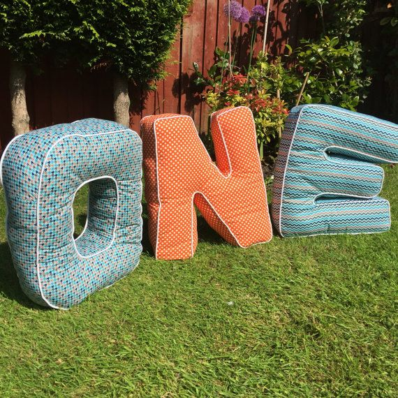 Giant stuffed letters made to order . It's 22 inch tall and up to 20 inch wide.   Other fabric options available, you might want to tell me of your preferred colour scheme, or favourite animals/characters ect. Or you can design your letter and send me a picture of it, I'll do my best to make a copy.Can add a pocket on the letter, or aplique the whole name on it to make it all personalised.   The letter is stuffed with non-allergenic polyester foam suitable for soft toys, machine washable in…