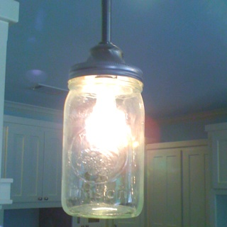 I made these lights from canning jars and a down rod from Lowes.