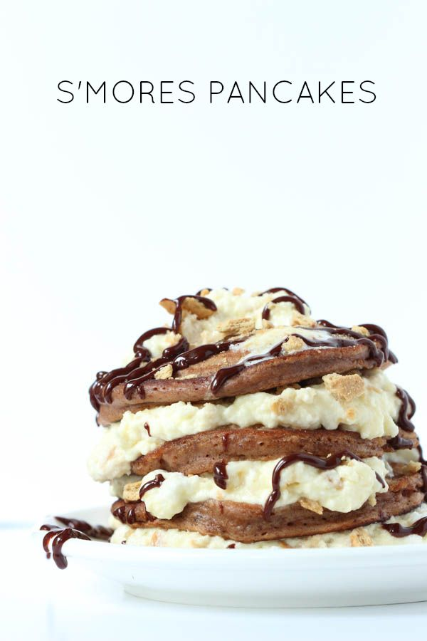 S'mores Pancakes - chocolate pancakes with toasted marshmallow graham cracker cream and chocolate sauce!