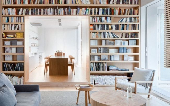 The living area of Robin Boyd's renowned 'Bridge House' in Toorak, Melbourne — renovated by architect Steven Jolson nearly 60 years after it was built — is furnished with a low-key but luxe informality.