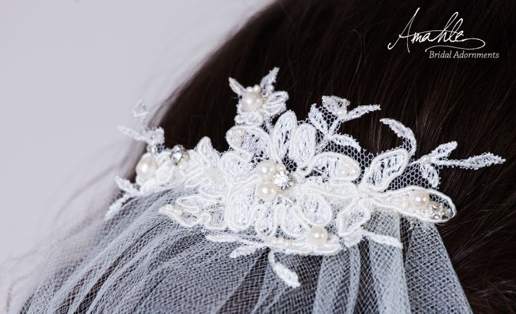 A bespoke lace, freshwater pearl and crystal veil made for the beautiful bride Rose