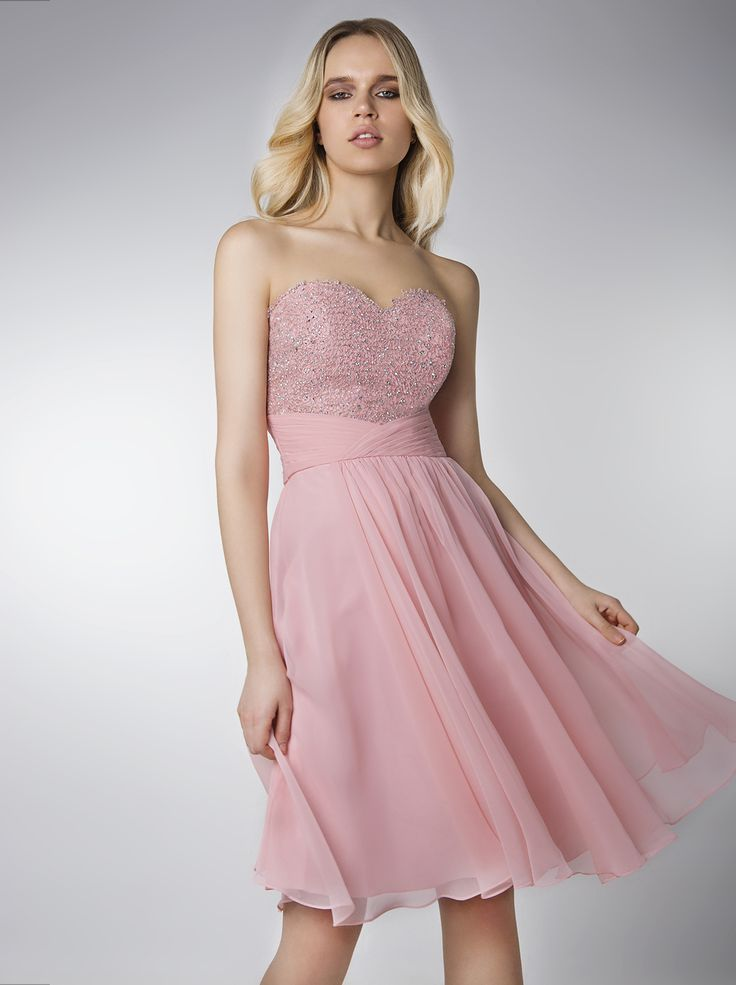 Short evening strapless dress with beaded bust.