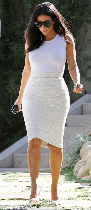 A little boost: The 33-year-old added inches to her petite frame with dove grey heels that had see-through sides