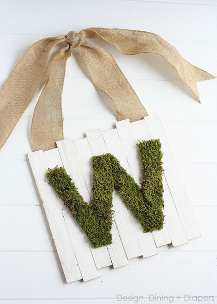 Decorate your front door with this unconventional yet delightful monogrammed sign, hung from a thick burlap ribbon. Get the tutorial at Design Dining Diapers.   - CountryLiving.com