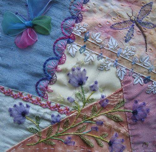 Love the sheer ribbon work...purple flowers