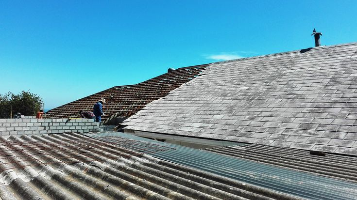 Roof being stripped of the current tiles