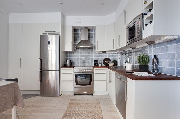 Marbodalkök i vinkel och rostfria vitvaror
