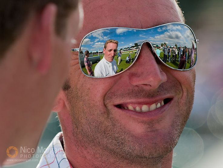 Terry Boon's sunglasses reflect Oliver Townend and the Burghley Horse Trials Dressage Arena.