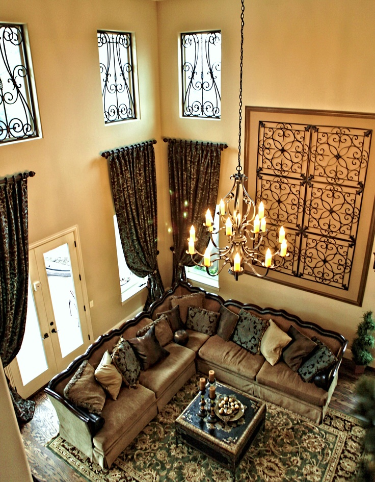 Two story traditional living room with faux iron window Great room curtain ideas