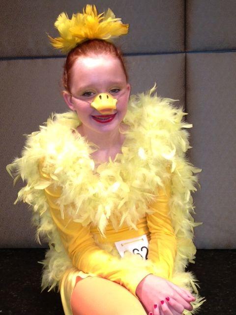 Halloween Duck Costume -Simple costume - yellow tshirt, feather boa and hot glue gun.  Hair comb - yellow feathers-hot glue gun. Quacktastic!