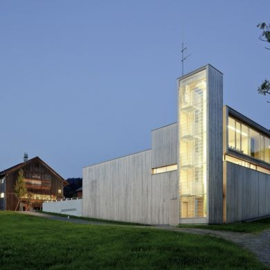 Fire Station In Sulzberg-Thal: Location: Sulzberg-Thal, Austria Year of Construction: 2011 Architects: Dietrich | Untertrifaller Architekten  Working into the topography of the site, this fire station features silver fur cladding which is consistent with the surrounding village. The timber constructed vertical volume with glazing on two sides provides natural light to pour in as well as a snapshot of the inner workings of a fire station.