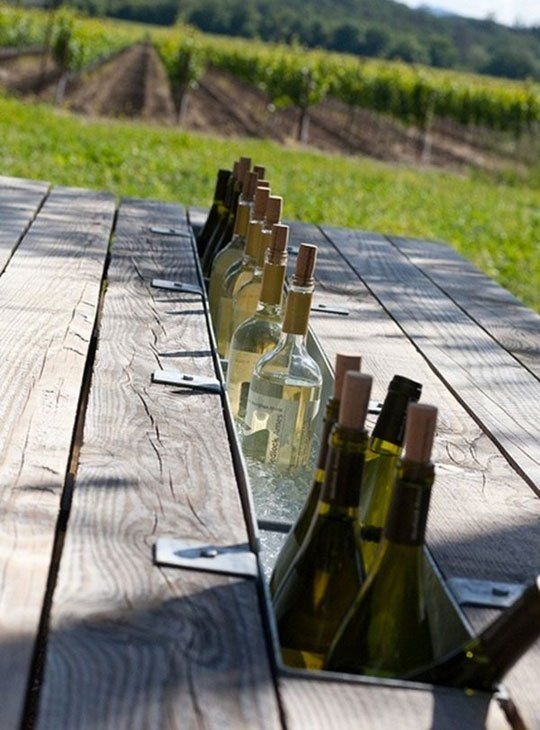 It may not be the season, but this outdoor picnic table with a wine cooler down the center made from a gutter is something you can start DIYing now to have ready for spring.