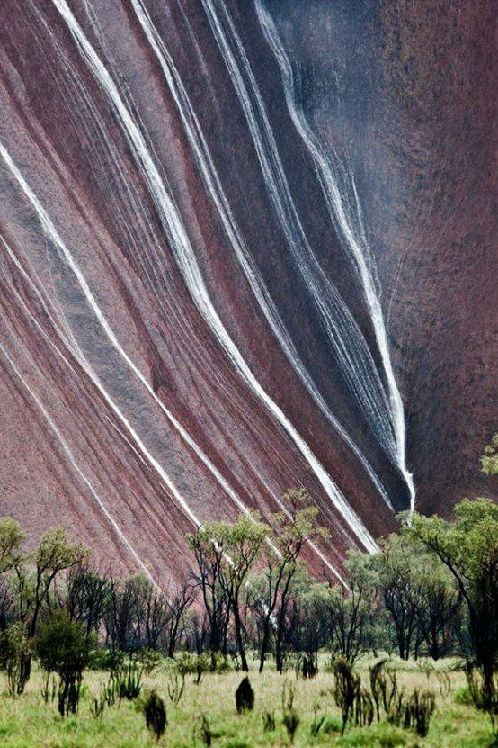 Ayres Rock- AU. Rain flowing off rock. Rained everyday we were there!