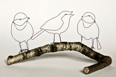 Emerging artist Hayley Dix uses fallen branches to perch her wire birds on, creating simple but charming three-dimensional drawings.