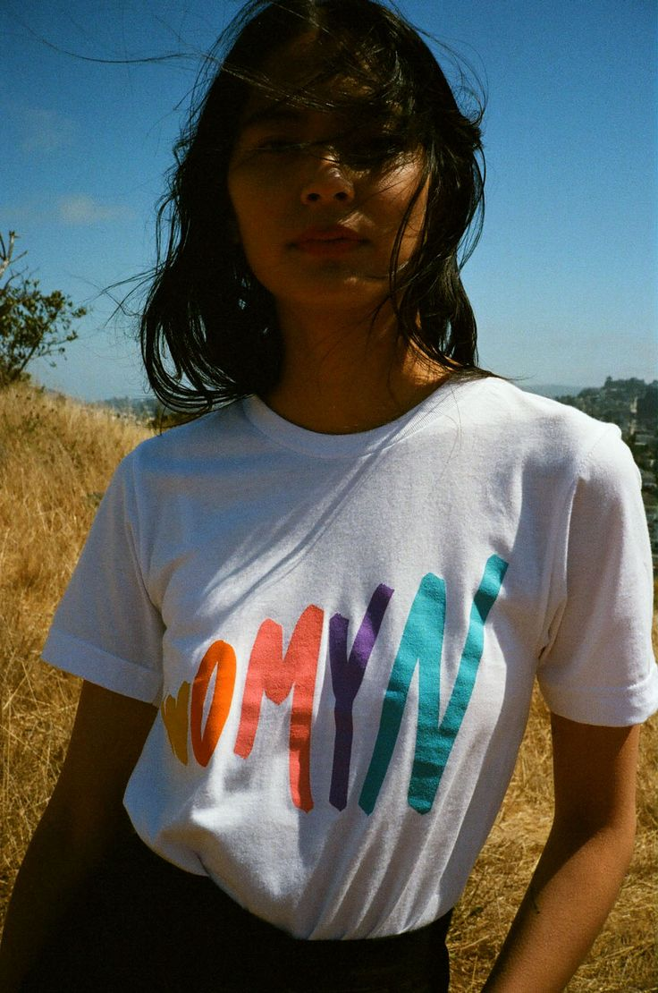 """First used as a feminist spelling of the word """"women"""" in 1976, Womyn was  used as an expression of female independence. That kind of statement  doesn't get old, plus it looks great on an 80's inspired graphic tee. Pair  with jeans and sneakers, or dress it up with trousers and a blazer."""