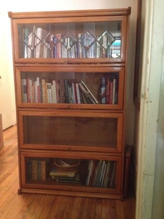 Solid oak bookcase with 4 shelves and glass windows.