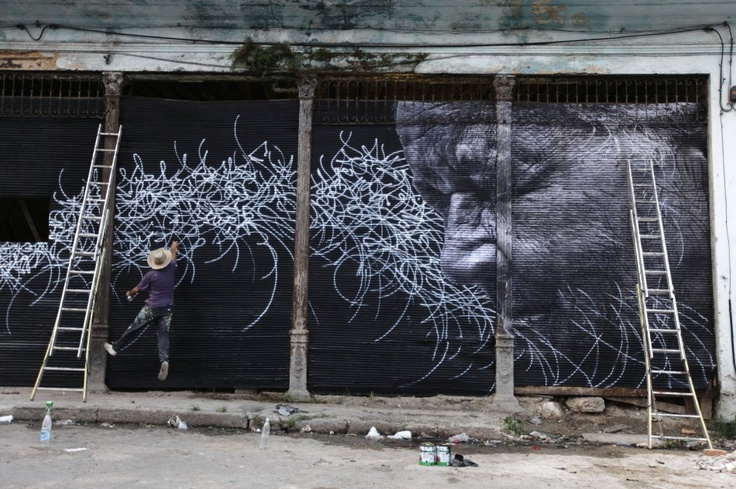 Cuban-American artist Jose Parla give his finishing touch to a creation in Havana