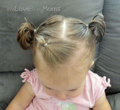 Place her bangs into an elastic and then put the rest of her hair into pigtails.