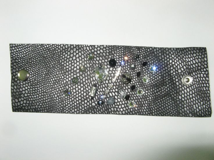 Leather cuff (1 pc)  Made with black/silver metal, swarovski crystals, glass beads and metals.