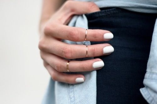 White nails and silver rings