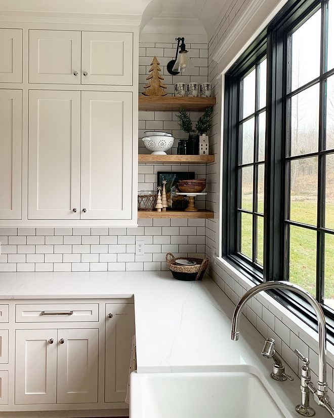 White Kitchen With Black Windows Subway Tile Backsplash With Black
