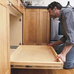 Build and install sliding shelves for kitchen cabinets from This Old House