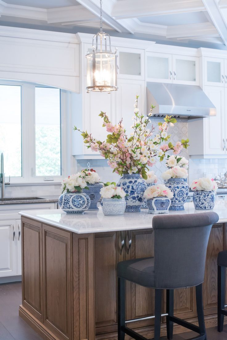 white and blue chinoiserie centerpiece on kitchen island ...