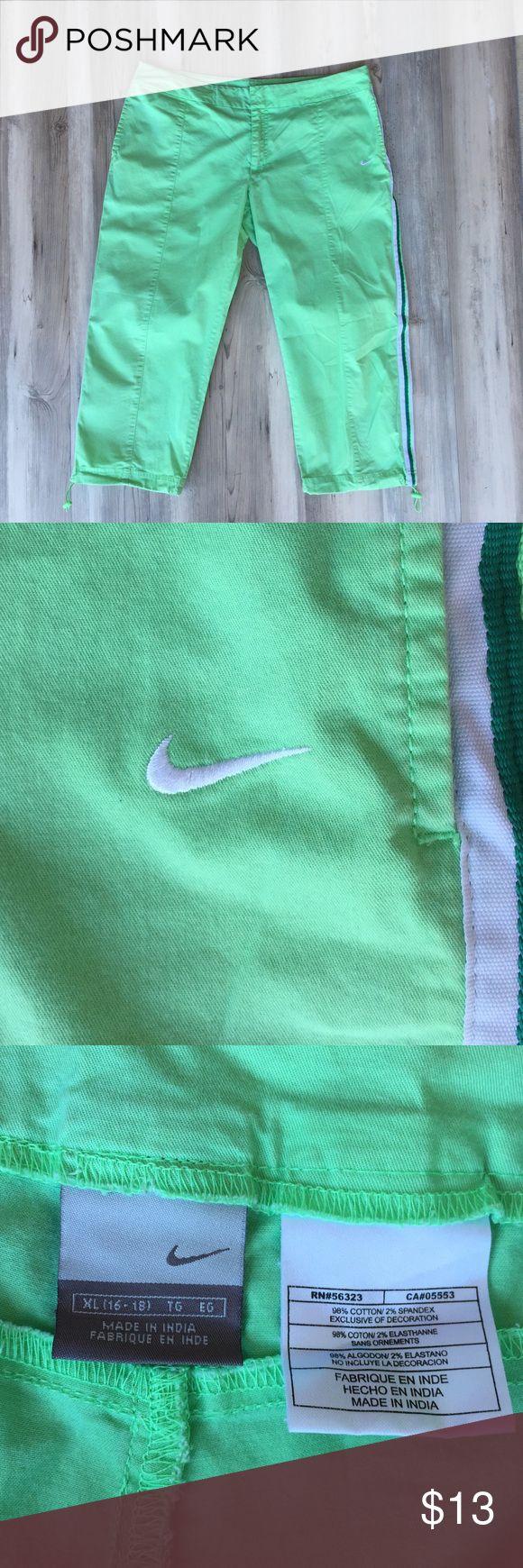 Nike Capri pants XL- green EUC Nike Capri pants with a dark green and white stripe down each pant leg!  Size is XL, see pics for measurements! Nike Pants Capris
