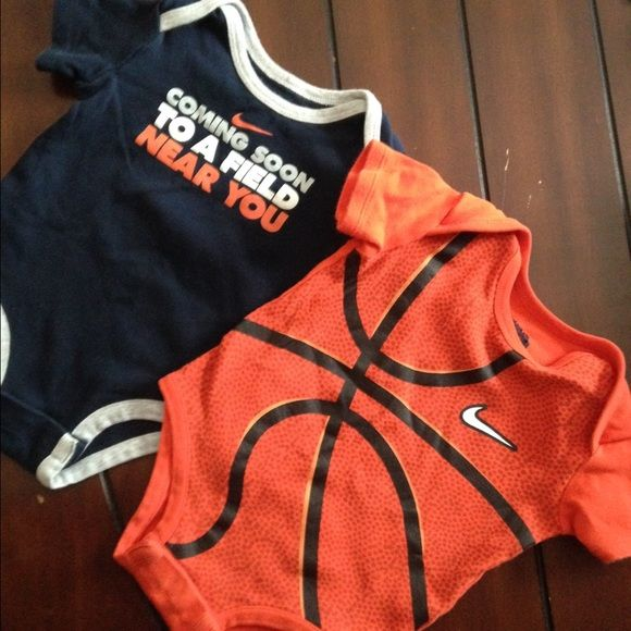 Nike baby onesies Boys 3-6 month Nike onesies. Great shape. Ones s basketball, and the other is football related. Nike Other