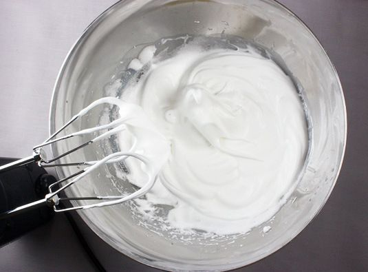"I've overbeaten my egg whites. Help! Here's a tip from Stephanie Jaworski of Joy of Baking: ""If you accidentally over-beat the egg whites, add one unbeaten white and whip again until stiff peaks form."" Remove 1/4 cup of egg white to come back to the original quantity needed in the recipe."