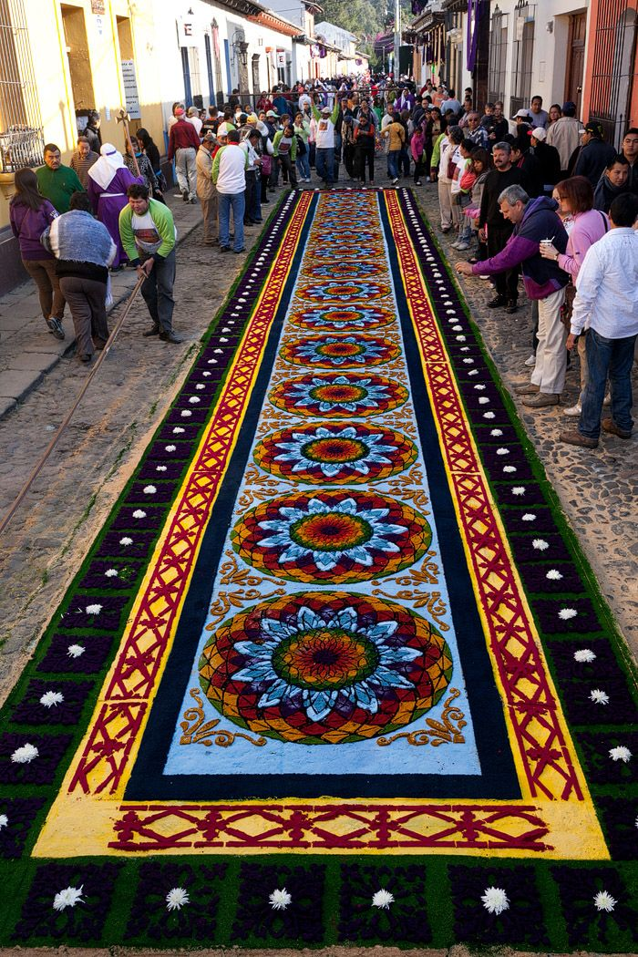 """Alfombras: Semana Santa in Antigua, Guatemala. Throughout Lent, and throughout Semana Santa (Holy Week) in Antigua, the streets would be covered in elaborate """"alfombras"""" or carpets, made out of colored sawdust, fruits, vegetables, and a wide range of other materials."""