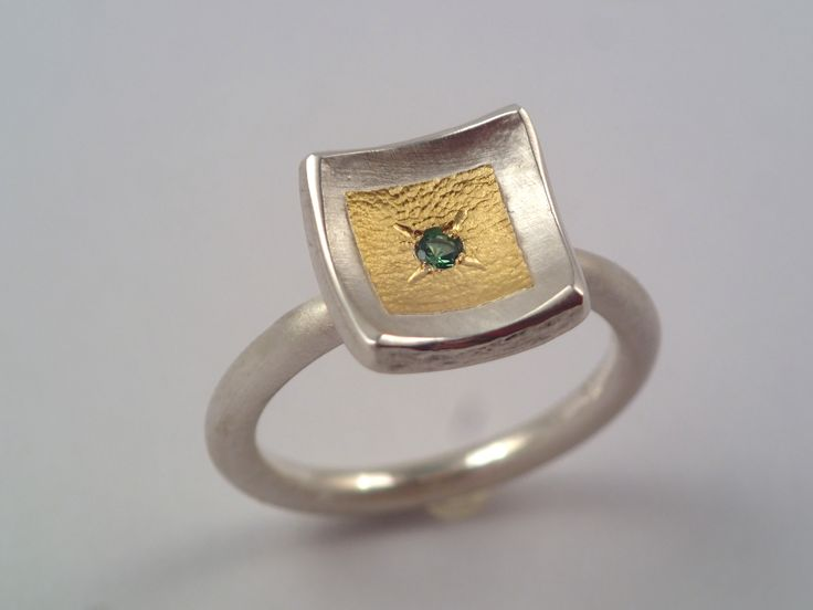 22K Gold and 925 silver ring with tsavorite stone.
