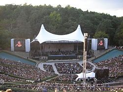 Waldbühne (German: Woodland Stage or Forest Stage) is an amphitheatre in Berlin, Germany. It was designed by German architect Werner March in emulation of a Greek theatre and built between 1934 and 1936 as the Dietrich-Eckart-Freilichtbühne (German: Dietrich Eckart Open Air Theater)