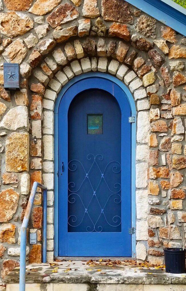 Blue door with unique stone work in Austin, Texas.