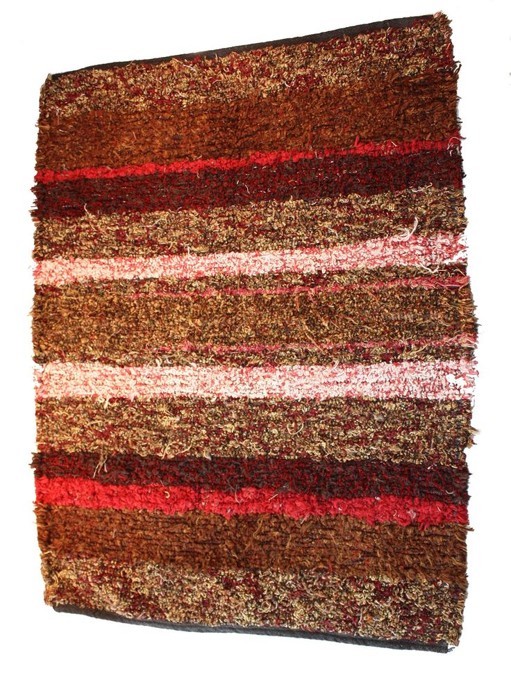 Washable Woven Rug 28 X 40. This rug is woven in my Michigan studio. It is made of upholstery fabric selvedges from the furniture mills down south. This rug is a variety of rose, pink, maroon, rust, white and broze. They are very durable as they are the same material as couchs and chairs are covered with. Machine wash and dry. They are quite thick, may not work in front of a door. Great for any floor, wood, tile, or on carpet. Great for living room, den, kitchen, bath. They feel wonderful...