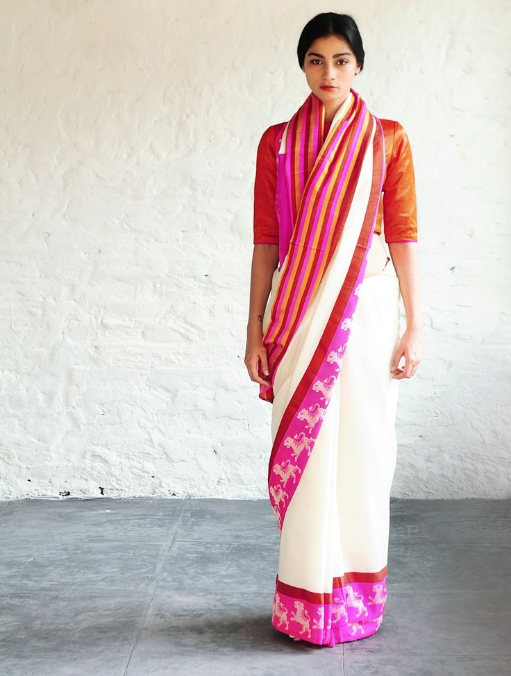 Nahar White-Fuschia Cotton-Silk Saree By Raw Mango   This exquisite cotton silk saree by Raw Mango is handwoven with mashroo, an age-old textile tradition. The word mashru is derived from the Arabic word sharia which means, permitted by Islamic law. Mashroo textiles were woven for Muslim communities, who held the belief that silk should not touch a person s skin. To honor this belief while being dressed in luxurious clothing, weavers crafted a solution by mixing silk and cotton threads.