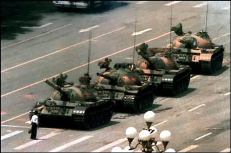 The Tiananmen Square protests of 1989 were a series of demonstrations in and near Tiananmen Square in Beijing, China.   The demonstrations were sparked by the death of a pro-democracy  and anti-corruption official Hu Yaobang.This photo shows the PLA's (People's Liberation Army) advancing tanks being halted by an unknown man near Tiananmen Square. Photographer: Jeff Widener