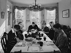 Saying grace before carving a turkey at Thanksgiving dinner in Neffsville, Pennsylvania, 1942