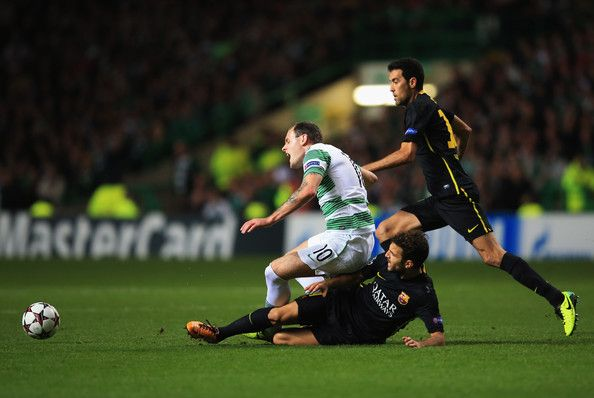 Anthony Stokes of Celtic is fouled by Cesc Fabregas of Barcelona during the UEFA Champions League Group H match between Celtic and FC Barcelona at Celtic Park Stadium on October 1, 2013 in Glasgow, Scotland.