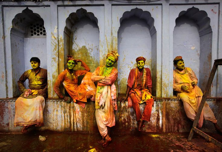 Indian villagers from Nandgaon wait for the arrival of villagers from Barsana to play Lathmar Holi at the Nandagram temple famous for Lord Krishna and his brother Balram, in Nandgaon, India, March 22, 2013. ( Manish Swarup/Associated Press)