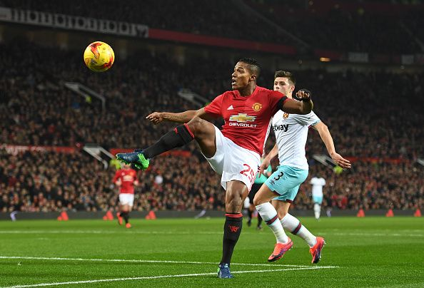 Antonio Valencia of Manchester United controls the ball ahead of Aaron Cresswell of West Ham United during the EFL Cup quarter final match between...