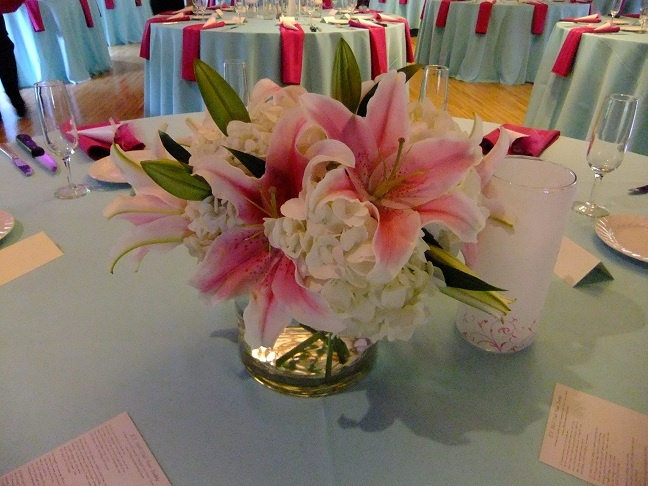 Stargazer lilies are the focal in this classic centerpiece at the Darby House.  www.bloomtasticweddings.com